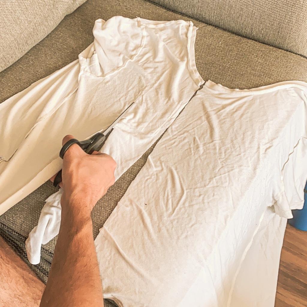 Matt cuts a white t-shirt into strips